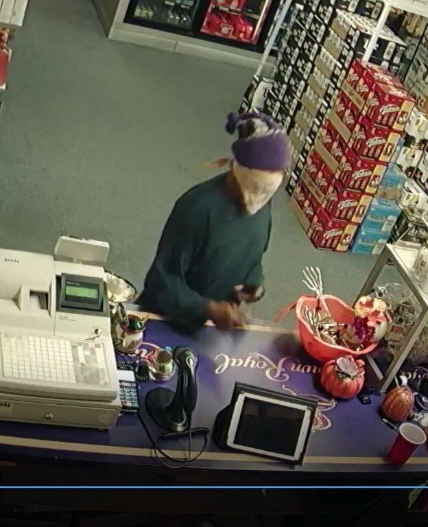 Terre Haute Police provided a surveillance photo from a robbery at Mr. M's Liquor at 25th and College